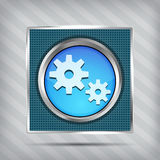 Blue metallic icon with gear on knob Royalty Free Stock Images