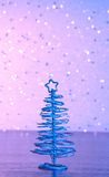 Blue metallic modern christmas tree on wood table Royalty Free Stock Photo