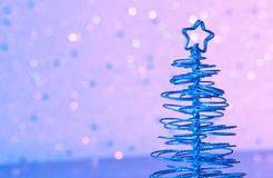 Blue metallic modern christmas tree on wood table Stock Photos