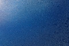 Blue metallic surface covered with water droplets. Texture, abstract background Stock Photo