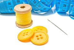 Blue meter, buttons and spool of thread Royalty Free Stock Photo