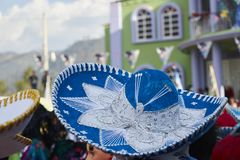 66/5000 mexican charro or mariachi blue hat at a mexican party. Approaching a charro or mariachi hat blue and white embroidery, at a popular Mexican party royalty free stock photos