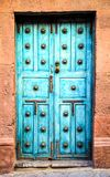 Blue Mexican Front Doors with Copper Door Handle. Blue Mexican Wooden Front Doors with Copper Door Handle royalty free stock images