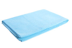 Blue microfiber bath towel close-up on a white background isolated Stock Photo