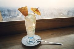 Blue milk shake. Beautiful dessert in restaurant. White ice cream on the table in the cafe with a beautiful view. Blue milk shake. Beautiful dessert in the stock photo