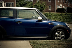 Towson, MD - 2010: Blue Mini Cooper Parked on Street royalty free stock photo