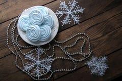 Blue mini meringues and decorations Stock Image