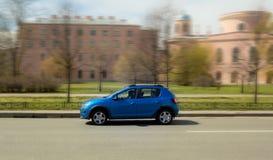 Blue minicar Stock Images