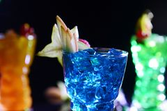 Blue cocktail with fruits in a glass stock photography