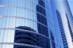 Blue mirror glass facade skyscraper buildings royalty free stock photography