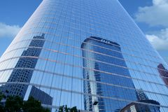 Blue mirror glass facade skyscraper buildings stock photo