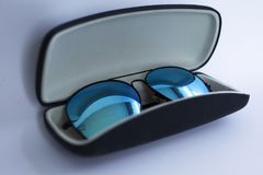 Blue mirrored sunglasses in a case stock images