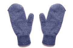 Blue mittens, isolated. Blue knitted mittens, isolated on white background Royalty Free Stock Photos