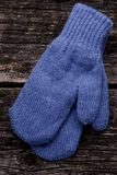 Blue mittens. On wood background Stock Image
