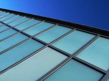 Blue Modern Building Detail, background. Modern buidling detail against bright blue sky, abstact background Stock Images