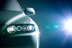 Blue modern car closeup. Light Royalty Free Stock Photos