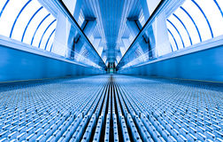 Blue modern escalator Stock Image