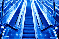 Blue modern escalator Royalty Free Stock Photos