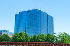 Blue modern office building with antennas Royalty Free Stock Photography