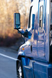 Blue modern semi truck with lot of reflaction Royalty Free Stock Photography