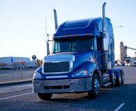 Blue modern semi truck rig with custom chrome parts Stock Photography