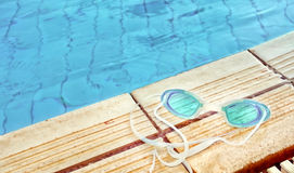 Blue modern Swim goggles. On the swimming pool Stock Image