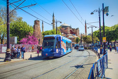 Blue modern tram moving along historical Sultanahmet square Stock Photo