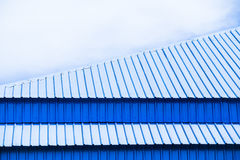 Blue modern warehouse roof against blue sky Royalty Free Stock Image