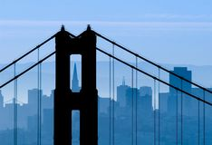 Blue Monday. Golden Gate Bridge silhouetted against the San Francisco Stock Photography