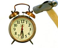 Blue Monday. An alarm clock being smashed on Monday morning. Who wants to go to work Royalty Free Stock Photo