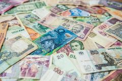 Blue money bill in front of different international banknotes. Perspective of australian blue money bill on other colorful international banknotes royalty free stock photography