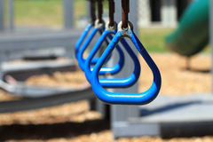 Blue Monkey Bar Rings. At a park outside Stock Photography