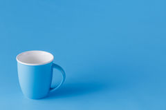 Blue monochromatic mug with copy space Royalty Free Stock Image