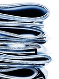 Blue monochromatic stack of business, legal or insurance papers. Stack of folded business, legal or insurance papers with monochromatic blue color Stock Photography