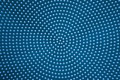 Black and white monochrome dots in the form of a circle large. Blue monochrome abstract dots in the form of a circle large form like some mechanism stock photo