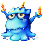 A blue monster celebrating a birthday Royalty Free Stock Images