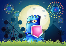 A blue monster holding a pink shield Royalty Free Stock Photo