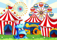 A blue monster near the circus tents Royalty Free Stock Photo