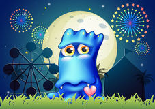 A blue monster near the grass at the carnival Stock Photography