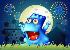 A blue monster strolling at the carnival in the middle of the ni Royalty Free Stock Photos