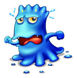 A blue monster trying to escape Royalty Free Stock Image