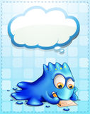 A blue monster writing with an empty cloud callout Stock Photo