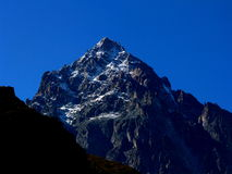 Blue Monviso Piedmont Italy Europe. Snowy peak of Monviso under a blue sky Stock Photo