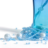 Blue mood 3. The image of a bottle with perfumery water and the scattered thread of a beads Stock Photo