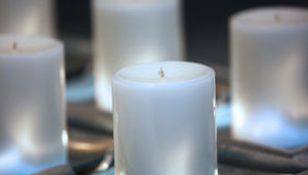 Blue mood candles. Soft romantic light with white candles Royalty Free Stock Photos