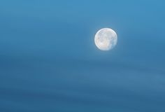 Blue Moon in Blue Sky Stock Image