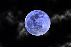Blue moon and clouds Royalty Free Stock Image
