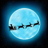 Blue moon and flying Santa Royalty Free Stock Photos