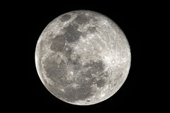 Blue moon. A fullmoon with its craters stock photography