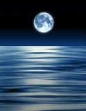 Blue Moon Ocean. Blue moon over ocean composite abstract Stock Photo